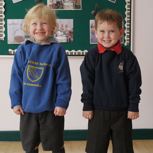 Children with hearing loss in their school uniforms